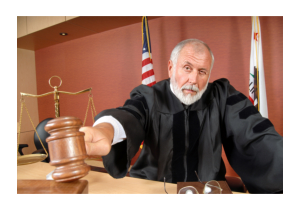 a male judge holding a wooden mallet