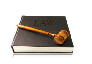 law book and wooden mallet